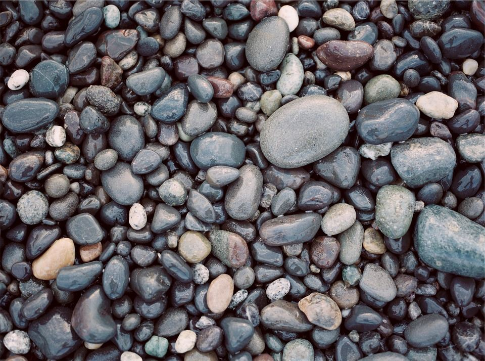 Should I Use Pebbles in my Pond?