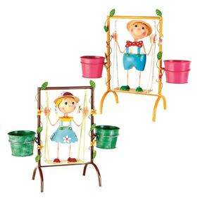 Boy on Swing with Colourful Garden Planter