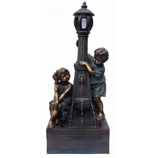 Playful Boy & Girl at Lamppost Lit Water Feature
