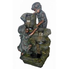Boy & Girl at Rock Formation Lit Water Feature