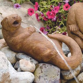 Lying Otter Plumbed Cast Stone Pond Spitter