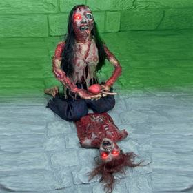Zombie Woman With Gory Body Parts Eating Victim With Red LED Eyes